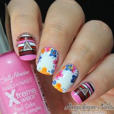 Flowers, stripes, and triangles. This is a unique mani!