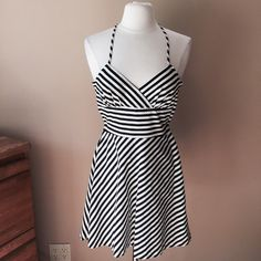 White House Black Market Striped Halter Dress Black and white halter dress with back zipper, fully lined. Pinned on size 6/8 mannequin (37-26-37)Check out the $6 section near the bottom of my closet (before the sold items) for lots of bundle-worthy $6 items! 15% bundle discount on 2+ items in a bundle. White House Black Market Dresses