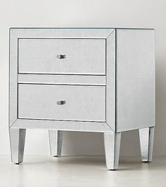 Art Deco-inspired nightstand in mirrored silver leaf.