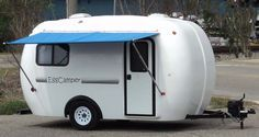 Sweet fiberglass camper. Very Spartan.