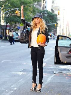 rag & bone/JEAN zipper jeans, spotted wedge heels, a covetable Chanel bag, staple blazer, white T-shirt, and wide-brimmed hat