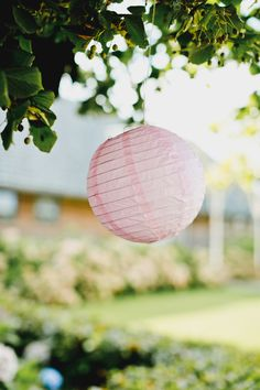 Baby pink hanging paper lantern - Image by Nadine van der Wielen Photography - Cymbeline Lace Wedding Dress for a white & pink classic wedding in the Netherlands with ombre stationery & cake.