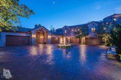 Reminiscent of the rich collection of architecture typical of Southern France, this rustic stone retreat artfully blends superior design with stone and beam architectural elements rarely found in recently constructed estates. Through the private gates and up a tree-lined drive the lofty stone porte-cochere leads to a grand circular motor court finished in sand set pavers with a limestone fountain imported from Provence as its focal point. $4,395,000.00 Call 805.207.6713