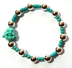 This beautiful bracelet is made with turquoise disc beads and silver plated beads. Another of my latest creations. As all of them is handmade. Also is accentuated by a turquoise Happy Buddha bead, strung onto sturdy elastic cord. It is 7 inches adjustable, and one size fits most, but dont hesitate to contact me if you need a bigger size.  Product Details - 10 mm Buddha head bead - Adjustable size - 8 mm Silver plated beads - 3 mm Turquoise disc beads - Length: 7 inches adjustable