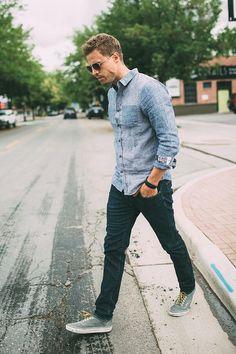 Shop this look on Lookastic: https://lookastic.co.uk/men/looks/light-blue-denim-shirt-navy-skinny-jeans-grey-plimsolls/18055   — Light Blue Denim Shirt  — Black Bracelet  — Navy Skinny Jeans  — Grey Plimsolls