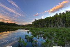 Natick Broadmoor Wildlife Sanctuary - Sunset at Mass Audubon's Broadmoor Wildlife Sanctuary in Natick Massachusetts showing a magical mixture of clouds, twilight and pond flora.  Broadmoor Wildlife Sanctuary sunset photography images are available as museum quality photography prints, canvas prints, acrylic prints or metal prints. Prints may be framed and matted to the individual liking and room decor needs…