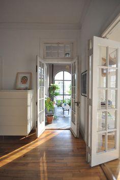 open doors and wooden floors.
