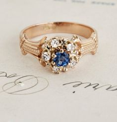 $1250.00  1890s Sapphire and Diamond Cluster Ring