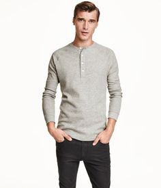 Henley shirt in waffle-knit jersey. Button placket and long raglan sleeves with ribbed cuffs.