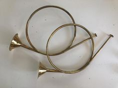 Vintage Brass French HornS *Sold Separately* Large - Material: brass - Measurements: x x - Wear: great condition Medium w/ Rope Hanger - Material: brass - Measurements: x x - Wear: great condition Small - Material: brass - Measurements: x x - Wear: great