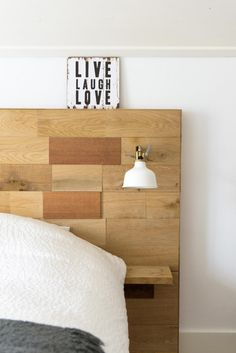 Bed with wooden headboard and reading lamp   Styling Mirella Timmers   Photographer Ronald Zijlstra   vtwonen February 2015