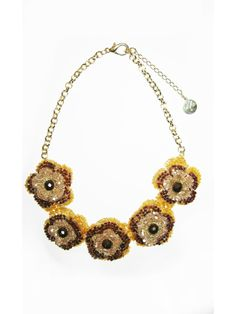 Golden link necklace embellished with beaded flowers, handmade by artisans from Brazil