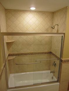 Bathtub door and tile (would like thinner profile on door surround though)