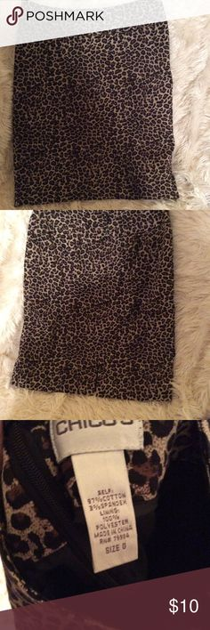 Chico's Animal Print Skirt Super cute skirt. Fits about a small stretchy and comfy. Great cond    •Please feel free to make offers! ✅ Sales through Posh only! I am able to model most items I have posted! If I haven't already- just ask 😊 Please ask for measurements if you need them! I include a small gift when gifts are available ☺️• Chico's Skirts Mini