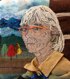 Self Portrait  by Susan L. Feller hooked, appliqué, embroidery, jewelry and linen shirt hand dyed wools.