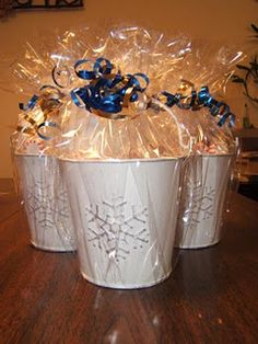 hot chocolate gift baskets- buckets from the dollar store filled with hot choc packets, peppermints, baggies of marshmallows, baggies of chocolate chips, and peppermint Hershey kisses.  Tie them up with a card and voila!  A cute, inexpensive gift.