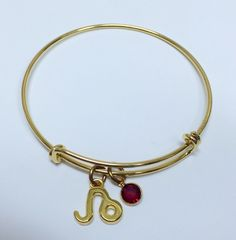 Gold Bangle Leo with July Birthstone ($22).