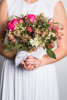 If you're all about the details, then your manicure will factor into that. Your nails need to perfectly complement your rings, skin tone, and, of course, the bouquet! Like this Rose Gold color.