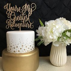 If you want a more subtle take, consider going for a simple wedding cake but dressing it up with a beautiful cake topper. We love this sentimental Up quote, from PS Weddings and Events!