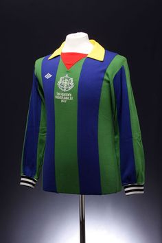 Specially commissioned kit for the 1977 Queen's Jubilee. Hampden Park hosted a match between the the English Football League and the Glasgow FA. The EFL played in a classic white kit, while Glasgow's finest were provided with a shirt featuring colours from all the teams that played. Snazzy