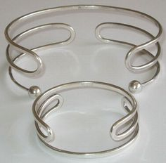 By Anna Greta Eker at PLUS, Fredrikstad, Norway for Norway Silver Designs A/S Year of design: 1960s Hallmarks: ND Norway Sterling 925 Material(s): Silver Measurements neckring (largest inner diameter): 4 5/8 inches Measurements bracelet (largest inner diameter): 2 1/2 inches.  effie-graa.com