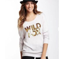 "Wildfox White Label Couture sequined sweater The Wildfox Couture Sequin Gold ""Wild Fox"" CrewNeck Sweater is a timeless piece. Constructed from a super soft and cuddly blend, this sweater features a wide crewneck and Wild Fox embellished in gold sequins across the front. It's the perfect knit that exudes unbeatable comfort and style. 45% Viscose / 40% Nylon / 15% Angora Measurement (Size S): 26″ Long / 20″ Bust Dry Clean Only Wildfox Sweaters"