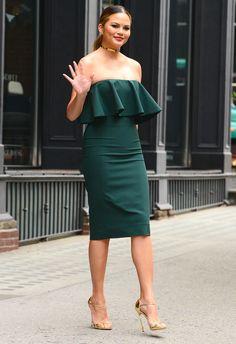 Chrissy Teigen in a green ruffle strapless dress