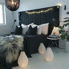 a black pallet bed can be DIYed and makes a bold statement in a light colored room