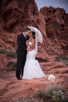 Lace umbrellas are so lovely at weddings #valleyoffirewedding  #desertwedding #lasvegaswedding #redrockwedding Photo Credit: Connie Palen