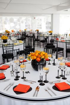 Bright black, white, orange and yellow modern NYC loft wedding, photos by Image Singuliere via JunebugWeddings.com