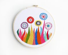 Embroidered Flower Garden in Rainbow Colors 8 inch Embroidery Hoop Wall Art by SometimesISwirl. $85.00, via Etsy.