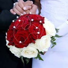 A truly beautiful rose bouquet. Love the contrast of the red and white together, and the delicate pearl embellishments.