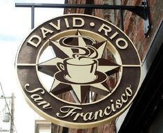 Sandblasted signfoam sign for David Rio San Francisco made of thick signfoam with reverse-cut center section and painted graphics. Shop Signage, Retail Signage, Outdoor Signage, Wayfinding Signage, Signage Design, Hanging Signs, Wall Signs, Sandblasted Wood, Commercial Signs