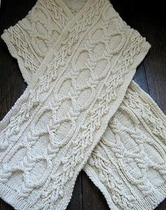 A scarf in classic, undyed wool with a briar rose and cabled motif.