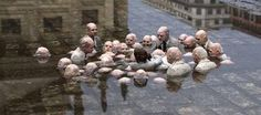 """This sculpture in Berlin has been dubbed """"politicians discussing climate change"""" by social media users. Sculpture by Spanish street artist Isaac Cordal, image via The Skeptics' Guide to the Universe. Banksy, Eco Architecture, Art Moderne, Art Mural, Street Artists, Graffiti Artists, Politicians, Global Warming, Public Art"""