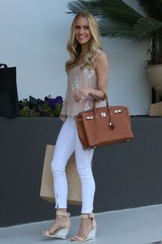 Kristin Cavallari - nude skull top, white pants, and a wedge. Flawless.