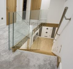 This staircase showcases structural glass at its best, without a handrail for a minimalist look. #StructuredGlass #Hallway