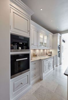 This luxurious white kitchen features exquisite detailing and quality appliances. This luxurious white kitchen features exquisite detailing and quality appliances. Luxury Kitchen Design, Kitchen Room Design, Kitchen Cabinet Design, Kitchen Layout, Interior Design Kitchen, Home Design, Design Ideas, Kitchen Cabinets, Luxury Bedroom Design
