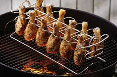 There is no better time of year to fire up the grill than Summer — but sometimes grilling standards (burgers, dogs, brats, metts) get a little tired. Throw chicken into the mix with the Chicken Leg Grill Rack ($20). This 15-inch-long rack holds a dozen chicken legs, and can be placed directly on your grill, cooking the meat to perfection. Stainless steel construction makes it a breeze to clean, and means it will last for grilling seasons to come. So, bring on the barbecue sauce and get…