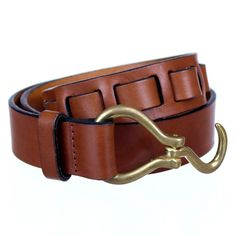 The Apolis Hoofpick Belt is constructed with Italian bridal leather sourced from Italy with Brass hardware. The hoofpick belt is a classic equestrian-inspired belt, whose hardware is often carried by horsemen enabling them to pick a store out of their horse's hoof.