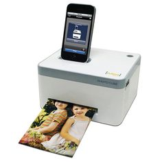 VuPoint Photo Cube Portable Photo Printer and Docking Station. Use it to view, print, and charge your iPhone, iPod touch or iPad. Sweet.