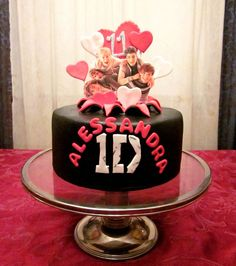 8in Red Velvet cake with exploding top..looks like One direction boys are jumping out of the cake ;)
