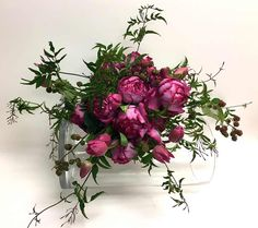 The freeform bouquet featuring a bride's favorite flower is a popular trend. These bouquets are often horizontal, loose and free flowing or angular in form. The jasmine, peony and blackberry vine.