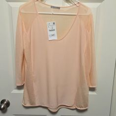 Zara Top Peach color top. The back is mesh/see through. 3/4 sleeves. Fits loose. Zara Tops