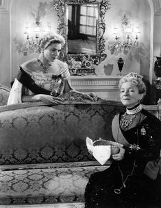Ingrid Bergman and Helen Hayes in ANASTASIA,a 1956 American historical drama film directed by Anatole Litvak.Also starring Yul Brynner.The film marked Bergman's return to Hollywood after several years working with her then-husband, Roberto Rossellini, in Italy. Anastasia won her an Academy Award for Best Actress, the second of three Oscars she would receive