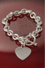 """This is a gorgeous """"Toggle style"""" sterling silver heart charm bracelet"""