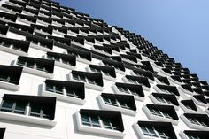 Monochrome Facade and Geometric Windows of NUS Cinnamon Residential Hall, Singapore. Photo by KSH