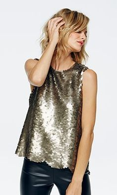 - Gorgeous pewter sequin tank with laser cut scalloped hem. - Lined in chiffon.