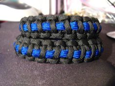 Thin Blue Line Survival Bracelets.  The Blue represents the officer and the courage they find deep inside when faced with insurmountable odds.    The Black background was designed as a constant reminder of our fallen brother and sister officers.    The Line, the line is what police officers protect, the barrier between anomie and a civilized society, between order and chaos, between respect for decency and lawlessness.    Together they symbolize the camaraderie law enforcement officers all…