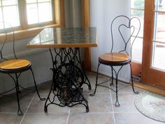The Bear Cupboard: GRANITE-TOPPED TABLE WITH ANTIQUE SEWING MACHINE LEGS FOR SALE